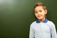 Boy at blackboard Royalty Free Stock Image