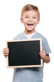 Boy with blackboard Royalty Free Stock Images