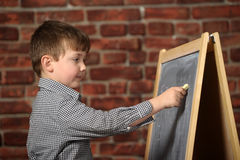 Boy  at the blackboard Stock Photography