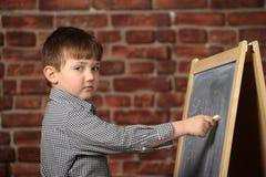 Boy  at the blackboard Royalty Free Stock Image