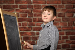 Boy  at the blackboard Royalty Free Stock Images