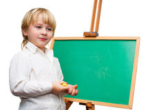 Boy at the blackboard Stock Photos