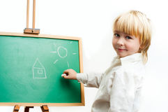 Boy at the blackboard Royalty Free Stock Photo