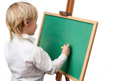 Boy at the blackboard Stock Photo