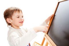 Boy at blackboard Stock Photos