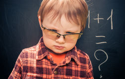 Boy at blackboard Royalty Free Stock Images