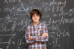 Boy and blackboard filled with math formulas Stock Photo