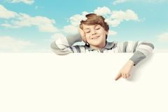Boy with a blank billboard Stock Image