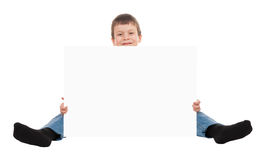 Boy with blank paper sheet Stock Photo