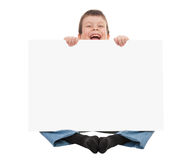 Boy with blank paper sheet Stock Photography