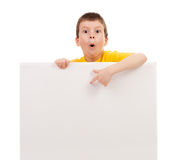 Boy with blank paper sheet Royalty Free Stock Photo