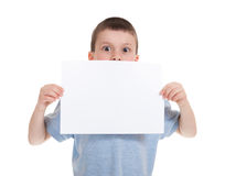 Boy with blank sheet paper Royalty Free Stock Images