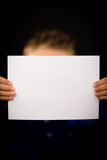 Boy with blank white sign Stock Images