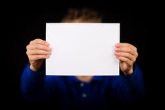 Boy with blank white sign Royalty Free Stock Photography