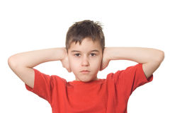 Boy blocking his ears Stock Photo