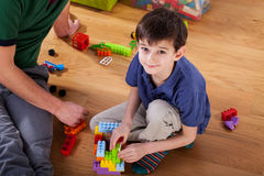 A boy with blocks on the floor Royalty Free Stock Photo