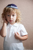 The boy with blond curls in the Jewish yarmulke Royalty Free Stock Image
