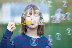 Boy with Blond Hair Blowing Bubbles Stock Photography