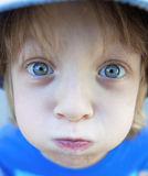 Boy with Blond Hair Making Faces Stock Photography