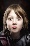 Boy with Blond Hair Making Faces Royalty Free Stock Photos