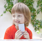 Boy with Blond Hair Playing Cards Stock Photos