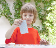 Boy with Blond Hair Playing Cards Royalty Free Stock Photography