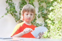 Boy with Blond Hair Playing Cards Royalty Free Stock Image