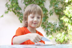 Boy with Blond Hair Playing Cards Stock Photography