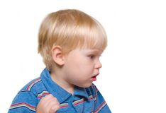 Boy-blond peers into side. Small child Stock Image