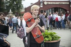 Boy blond with a skate in his hands smiling. Moscow, RUSSIA - June 12, 2019: Boy blond with a skate in his hands smiling stock photography