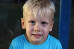 Boy with blonde hair royalty free stock photo
