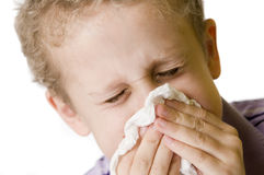 Boy blow nose closed eyes Royalty Free Stock Image