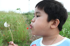 Boy blowing Stock Photo