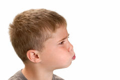 Boy Blowing Stock Image