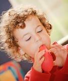 A boy blowing balloon Stock Photo