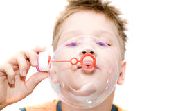 Boy blowing a bubble Stock Photo
