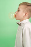 Boy blowing a bubblegum bubble Royalty Free Stock Images