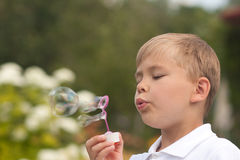 Boy blowing bubbles Royalty Free Stock Image