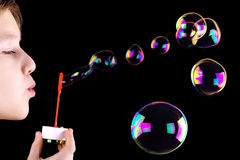Boy blowing bubbles Royalty Free Stock Images