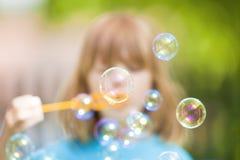Boy Blowing Bubbles Stock Photos