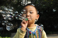 A boy blowing bubbles Stock Photography