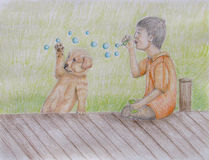 Boy Blowing bubbles for his Puppy Stock Photo