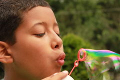 A boy blowing bubbles Royalty Free Stock Photography