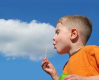 Boy Blowing Bubbles in Sky with Cloud Royalty Free Stock Images