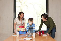 Boy blowing the candles Royalty Free Stock Photo