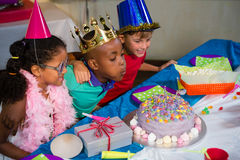 Boy blowing candles on cake Royalty Free Stock Images
