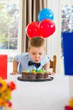 Boy Blowing Candles On Cake Royalty Free Stock Photo