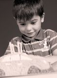 Boy blowing candles on cake, happy birthday party Royalty Free Stock Images