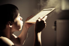 Boy blowing dust from chalk board Royalty Free Stock Photo