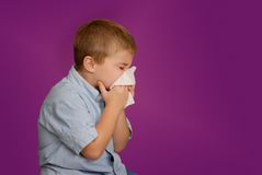 Boy Blowing Nose Royalty Free Stock Photos